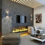 красивый камин в гостиной теплых оттенков