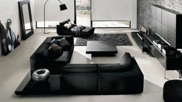 корпусная мебель черного цвета в дизайне гостиной