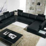 корпусная черная мебель в интерьере гостиной