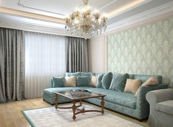 бирюзовый  диван с узорами и столик