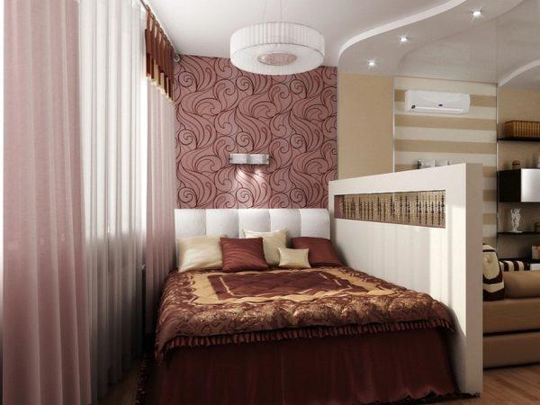 Коричнево-бежевая спальная зона в гостиной с перегородкой