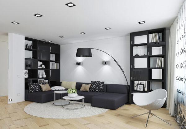 черная мебель в светлом интерьере современной гостиной комнаты