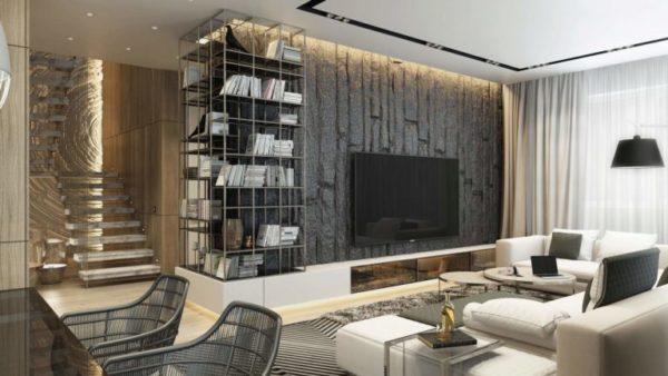 Большой телевизор на бетонной стене
